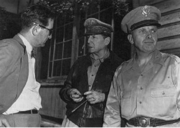 General MacArthur discusses the military situation with Ambassador John J. Muccio at ROK Army headquarters, 29 June 1950.