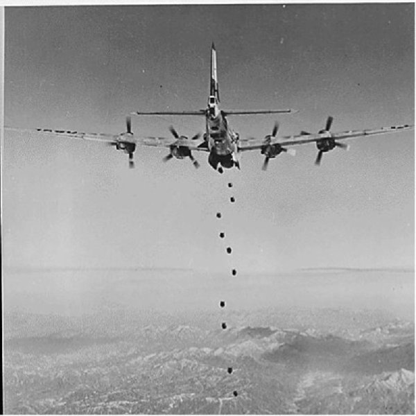 "Bombs Away regardless of the type of enemy target lying in this rugged, mountainous terrain of Korea, very little would remain after the falling bombs have done their work. This striking photograph of the lead bomber was made from a B-29 ""Superfort"" of the Far East Air Forces 19th Bomber Group on the 150th combat mission the 19th Bomber Group had flown since the start of the Korean war, ca. 02/1951"
