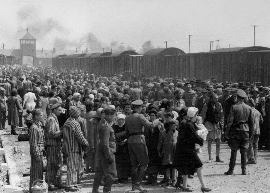 """Selection"" of Hungarian Jews on the ramp at the death camp Auschwitz-II (Birkenau) in Poland during German occupation, May/June 1944. Jews were sent either to work or to the gas chamber. The photograph is part of the collection known as the Auschwitz Album. See Auschwitz Album, Yad Vashem: ""The Auschwitz Album is the only surviving visual evidence of the process leading to mass murder at Auschwitz-Birkenau."""