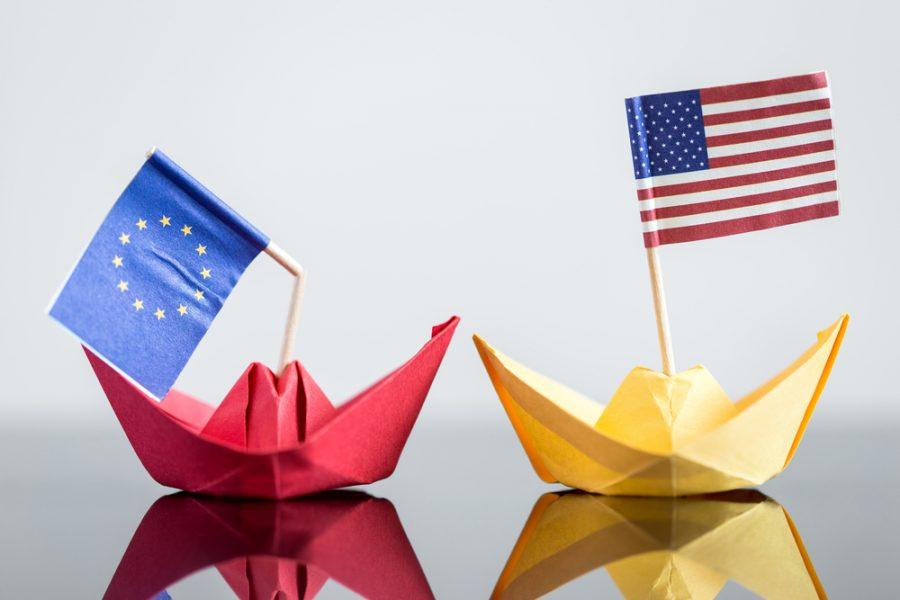 US paperboat leading EU paperboat with a broken flag