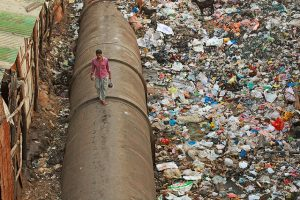 The journey to from market to home for a resident of the Dharavi slum.. by Meena Kadri. Flickr CC BY-NC-ND 2.0
