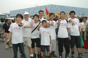 Climate Change Agents outside the Watercube, Beijing China. by Philip McMaster, via Flickr. CC BY-NC 2.0