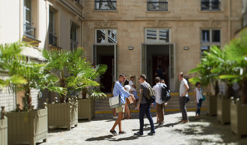Students conversing in courtyard of the Paris campus