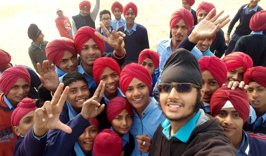 Jasdeep Hundal taking a selfie with children in Punjab, India in 2015