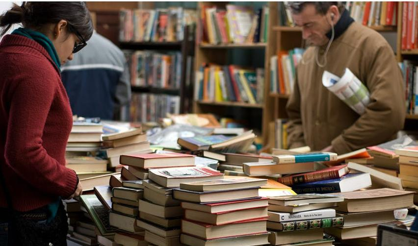 People browsing in a second-hand bookshop.