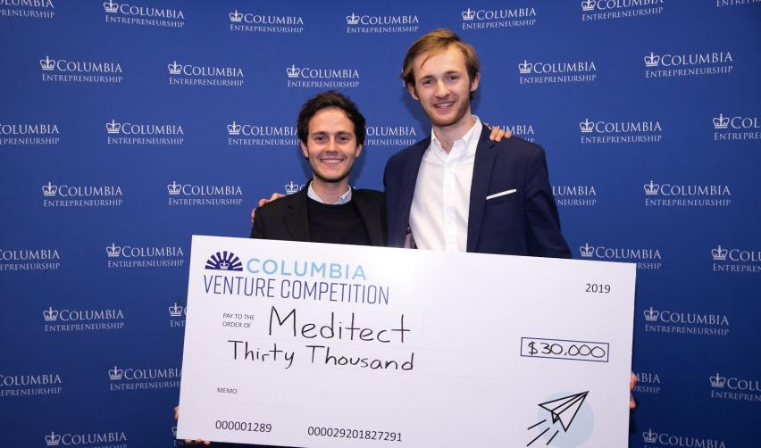 Co-founders of Meditect holding up 1st place prize