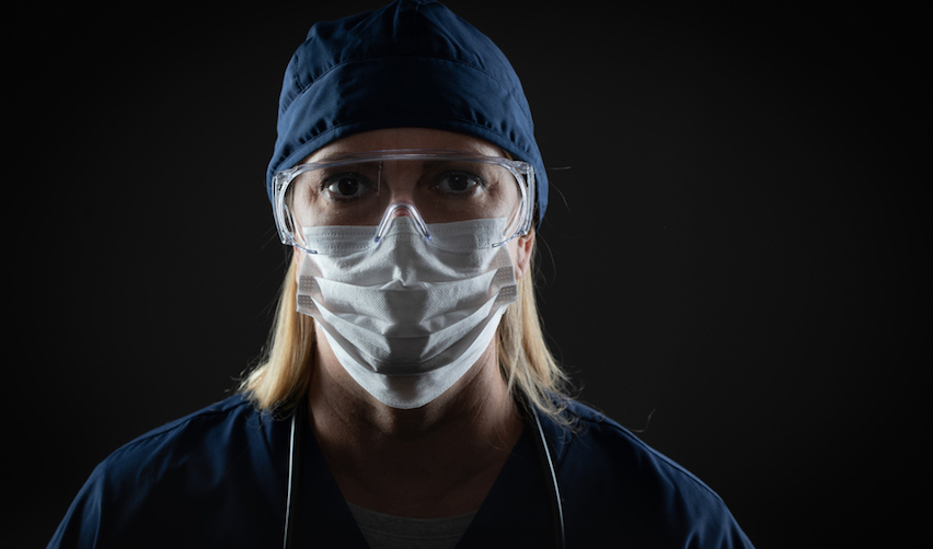 Female healthcare worker wearing a mask / Andy Dean Photography / Shutterstock