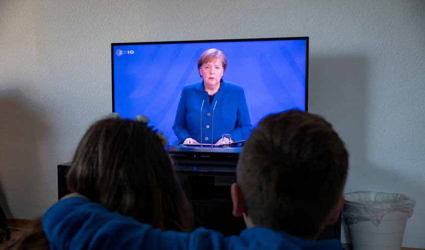 Dortmund 22.3.2020 Kids and people watching on TV Angela Merkel Chancellor