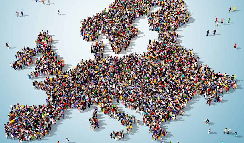 Large group of people seen from above gathered together in the shape of Europe