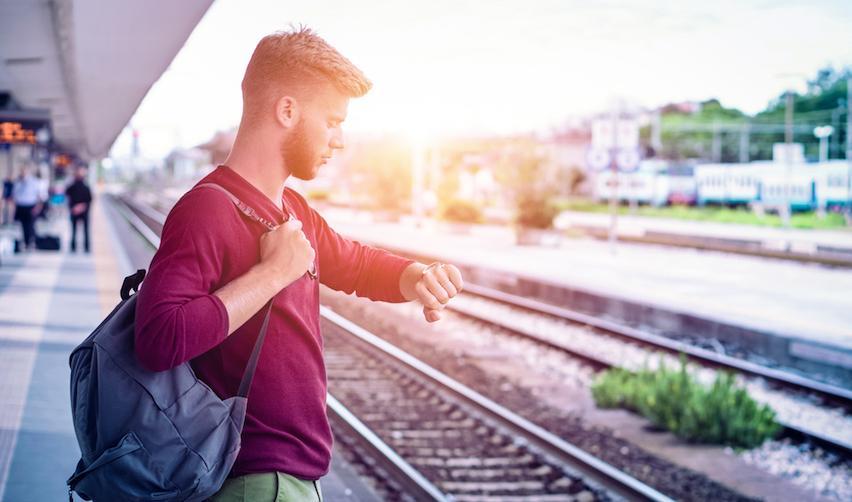 Student waiting for a train. © Akhenaton Images / Shutterstock